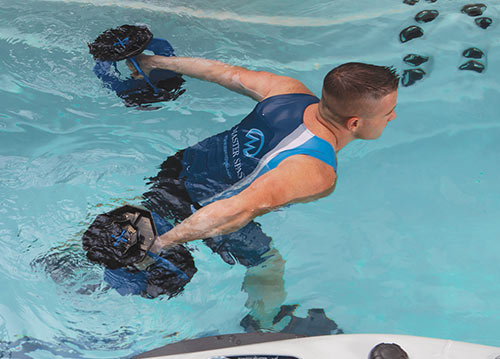 Man using weights in swimspa